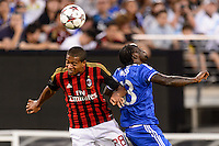 A. C. Milan midfielder Urby Emanuelson (28) goes up for a header with Chelsea F. C. forward Victor Moses (13). Chelsea F. C. defeated A. C. Milan 2-0 during round two of the 2013 Guinness International Champions Cup at MetLife Stadium in East Rutherford, NJ, on August 04, 2013.