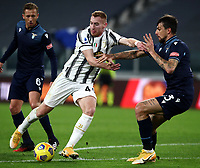 Calcio, Serie A: Juventus FC - S.S.Lazio, Turin, Allianz Stadium, March 6, 2021.<br /> Juventus' Dejan Kulusevski (l) in action with Lazio's Francesdco Acerbi (r) during the Italian Serie A football match between Juventus and Lazio at the Allianz stadium in Turin, on March 6, 2021.<br /> UPDATE IMAGES PRESS/Isabella Bonotto