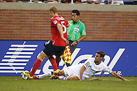 7 June 2011: USA Men's National Team forward Chris Wondolowski (11) tackles the ball from Canada defender Andre Hainault (5) during the CONCACAF soccer match between USA and Canada at Ford Field Detroit, Michigan. USA won 2-0.