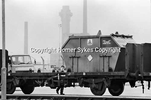 """Windscale and Calder Nuclear processing plant 1980s Cumbria UK. British Nuclear Fuels. Formally known as Sellafield 1983. Nuclear waste, a """"Full"""" container waiting to be """"trained"""" out of the plant. The triangular sign reads """"Full"""".<br /> <br /> My ref 5/4547/, 1983"""