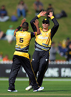 Wellington's Michael Bracewell congratulates Jeetan Patel for bowling Central Stags' Christian Leopard during the Dream11 Super Smash T20 cricket match between the Wellington Firebirds and Central Stags at Basin Reserve in Wellington, New Zealand on Thursday, 18 December 2019. Photo: Dave Lintott / lintottphoto.co.nz