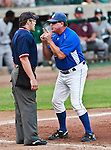 The Fort Worth Cats Manager, Stan Hough, shows his displeasure about a call with the home plate umpire, Shaylor Smith, during the American Association of Independant Professional Baseball game between the Gary Southshore Railcats and the Fort Worth Cats at the historic LaGrave Baseball Field in Fort Worth, Tx. Gary Southshore defeats Fort Worth 7 to 3.