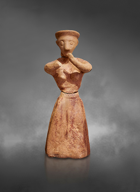 Minoan clay female figurine in the attitude of worship, Chamezi 1900-1700 BC; Heraklion Archaeological  Museum, grey background.