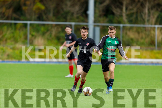 Tussle for possession between Asdee's Callum McSweeney and Ballymac Celtic's Gary Howard in the encounter in the Denny league.
