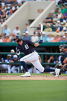Detroit Tigers center fielder JaCoby Jones (21) follows through on a swing during a Grapefruit League Spring Training game against the New York Yankees on February 27, 2019 at Publix Field at Joker Marchant Stadium in Lakeland, Florida.  Yankees defeated the Tigers 10-4 as the game was called after the sixth inning due to rain.  (Mike Janes/Four Seam Images)