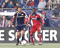New England Revolution substitute midfielder Juan Toja (18) on the attack. In a Major League Soccer (MLS) match, the New England Revolution (blue) defeated Chicago Fire (red), 1-0, at Gillette Stadium on October 20, 2012.