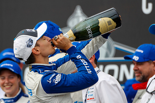 #10: Alex Palou, Chip Ganassi Racing Honda celebrates on the championship podium with champagne