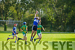 Donal O'Sullivan from St Brendans takes possession in the air as Lixnaws Eoin and Billy Stack bear down on him in the County Minor Hurling championship quarter final on Friday.