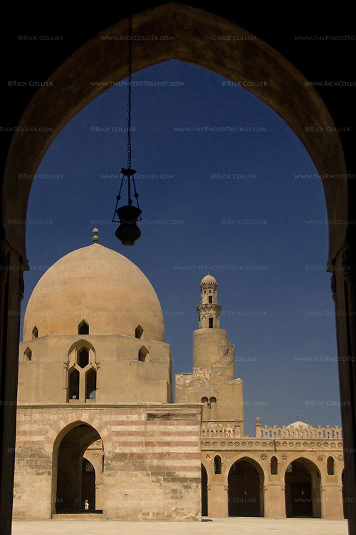 Cairo, Egypt -- The unique spiral minaret stands behind the impressive fountain (sahn) at the center of the historic ibn Tulun mosque. © Rick Collier / RickCollier.com
