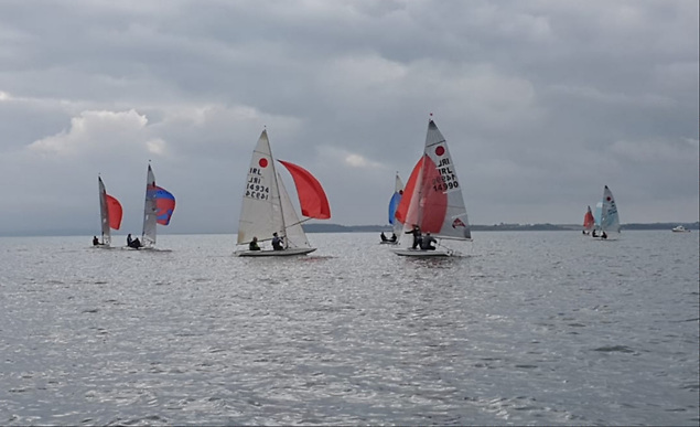 Some of the fleet picking their optimum angles on a very light downwind leg...