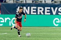 FOXBOROUGH, MA - AUGUST 29: Matt Polster #8 of New England Revolution brings the ball forward during a game between New York Red Bulls and New England Revolution at Gillette Stadium on August 29, 2020 in Foxborough, Massachusetts.