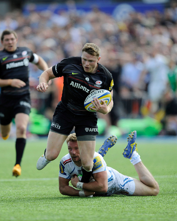 Chris Ashton of Saracens is brought down in the final seconds by Matt Jess of Exeter Chiefs