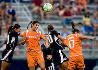 Sky Blue FC midfielder (10) Yael Averbuch heads the ball out of the box and away from the Washington Freedom's (20) Abby Wambach and (10) Homare Sawa at the Maryland SoccerPlex in Boyds, Maryland.  The Washington Freedom defeated Sky Blue FC, 3-1, to secure a place in the playoffs.