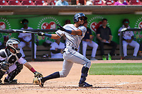 West Michigan Whitecaps shortstop Jose King (11) swings at a pitch during a game against the Wisconsin Timber Rattlers on May 22, 2021 at Neuroscience Group Field at Fox Cities Stadium in Grand Chute, Wisconsin.  (Brad Krause/Four Seam Images)