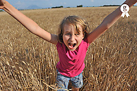 Girl in wheat field, shouting and jumping (Licence this image exclusively with Getty: http://www.gettyimages.com/detail/91934862 )