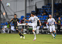 LAKE BUENA VISTA, FL - JULY 18: Joe Corona #15 of LA Galaxy plays the ball out of the air during a game between Los Angeles Galaxy and Los Angeles FC at ESPN Wide World of Sports on July 18, 2020 in Lake Buena Vista, Florida.