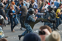Moscow, Russia, 06/05/2012..Police fight protestors at opposition demonstration against Russian Presidential election results on the eve of Vladimir Putins inauguration as President.