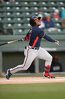 Right fielder Justin Dean (5) of the Rome Braves bats in a game against the Greenville Drive on Friday, April 19, 2019, at Fluor Field at the West End in Greenville, South Carolina. Greenville won, 2-0. (Tom Priddy/Four Seam Images)
