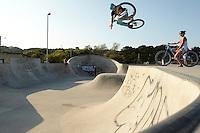 Clinton Johns riding DMR jump bike , with girlfriend Georgina .  Hayle skatepark , Cornwall .