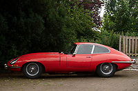BNPS.co.uk (01202) 558833.<br /> Pic: Zachary Culpin/BNPS<br /> <br /> A classic E-Type Jaguar a mechanic bought 43 years ago from a dentist for £1,500 is now tipped to sell for £75,000.<br /> <br /> Mike Lucas set his heart on the legendary British sports car after seeing the late Jimmy Hill drive one while manager of Coventry City.<br /> <br /> The 'beautiful' 1962 E-type Series I coupe was found to be a 'jumble of 1,000 parts' when Mike answered an advert for it in 1978.<br /> <br /> It took him over 30 years to repair and restore the bright red motor to its former glory.