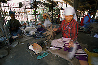 Under UNHCR protection, the life of 135000 Bhutanese refugees in one of the 7 camp near Damak, Nepal. Womans and mens are spinning woollen for few rupees..-The full text reportage is available on request in Word format