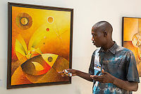 Artist Abdoukarim Fall, from Saint Louis, Displays his Work at Biannual Arts Festival, Goree Island, Senegal.