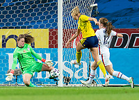 SOLNA, SWEDEN - APRIL 10: Alyssa Naeher #1 of the USWNT saves the shot of Emma Kullberg #16 of Sweden during a game between Sweden and USWNT at Friends Arena on April 10, 2021 in Solna, Sweden.