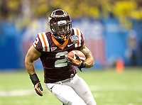 Josh Oglesby of Virginia Tech runs the ball during Sugar Bowl game at Mercedes-Benz SuperDome in New Orleans, Louisiana on January 3rd, 2012.  Michigan defeated Virginia Tech, 23-20 in first overtime.