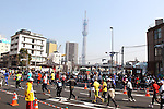 Feb. 27, 2011 - Tokyo, Japan - Runners race through the streets with a view of Tokyo Sky Tree far off in the distance during the Tokyo Marathon. (Photo by Yutaka/AFLO SPORT)