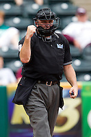 Home Plate Umpire Tom Svehla calls out a Missouri State Bears batter during a game between the Bradley Braves and the Missouri State Bears on May 13, 2011 at Hammons Field in Springfield, Missouri.  Photo By David Welker/Four Seam Images
