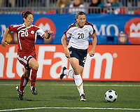 Marie Eve Nault, Abby Wambach. The US Women's National Team defeated the Canadian Women's National Team, 4-0, at BMO Field in Toronto during an international friendly soccer match on May 25, 2009.