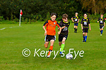 Cillian O'Donoghue MEK and Aaron O'Connor GB Rovers in action in their U13 FAI cup game in Fossa on Saturday