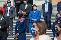 Members of Congress including United States Representative Ilhan Omar (Democrat of Minnesota) on the House steps of the US Capitol stand at a safe distance during a press conference ahead of the vote on the George Floyd Justice in Policing Act of 2020 in Washington, DC., Thursday, June 25, 2020. <br /> Credit: Rod Lamkey / CNP/AdMedia