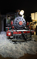 Pictured: A Christmas train in the showroom. Thursday 16 November 2017<br /> Re: Festive company which manufactures tinsel in Cwmbran, Wales, UK.