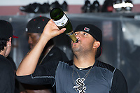 Kannapolis Intimidators pitcher Kelvis Valerio (22) celebrates in the clubhouse following the win over the West Virginia Power at Kannapolis Intimidators Stadium on June 18, 2017 in Kannapolis, North Carolina.  The Intimidators defeated the Power 5-3 to win the South Atlantic League Northern Division first half title.  It is the first trip to the playoffs for the Intimidators since 2009.  (Brian Westerholt/Four Seam Images)