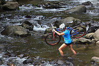 Crossing Iao Valley Stream, Maui, Hawaii with a mountain bicycle.