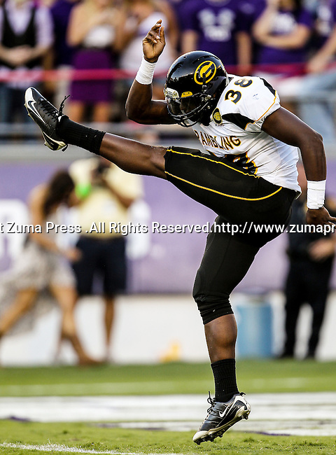 Grambling State Tigers punter Fabian Carter (38) in action during the game between the Grambling State Tigers and the TCU Horned Frogs  at the Amon G. Carter Stadium in Fort Worth, Texas. TCU defeats Grambling State 59 to 0.