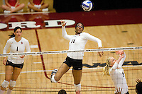 STANFORD, CA - DECEMBER 5:  Foluke Akinradewo of the Stanford Cardinal receives a set from Joanna Evans during Stanford's 3-0 win over Albany in the NCAA Division 1 Women's Volleyball first round on December 5, 2008 at Maples Pavilion in Stanford, California.