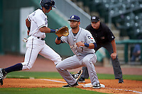 San Antonio Missions first baseman Luis Domoromo (7) waits for a pickoff attempt throw as Kenny Diekroeger (8) gets back to the bag during a game against the NW Arkansas Naturals on May 30, 2015 at Arvest Ballpark in Springdale, Arkansas.  San Antonio defeated NW Arkansas 5-1.  (Mike Janes/Four Seam Images)