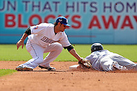 Buffalo Bisons shortstop Sean Kazmar #39 attempts to tag Chad Huffmann #17 as he slides in during a game against the Columbus Clippers at Coca-Cola Field on May 31, 2012 in Buffalo, New York.  Columbus defeated Buffalo 3-0.  (Mike Janes/Four Seam Images)