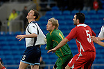 International Friendly match between Wales and Scotland at the new Cardiff City Stadium : Wales goalkeeper Wayne Hennesey tugs the shirt of Scotlands Gary Caldwell.