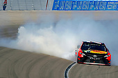 2017 Monster Energy NASCAR Cup Series - Kobalt 400<br /> Las Vegas Motor Speedway - Las Vegas, NV USA<br /> Sunday 12 March 2017<br /> Martin Truex Jr, Bass Pro Shops/TRACKER BOATS Toyota Camry celebrates his win with a burnout <br /> World Copyright: Russell LaBounty/LAT Images<br /> ref: Digital Image 17LAS1rl_5168