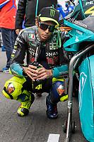 29th August 2021; Silverstone Circuit, Silverstone, Northamptonshire, England; MotoGP British Grand Prix, Race Day; Petronas Yamaha SRT rider Franco Valentino Rossi sits next to his Yamaha YZR-M1 on the grid
