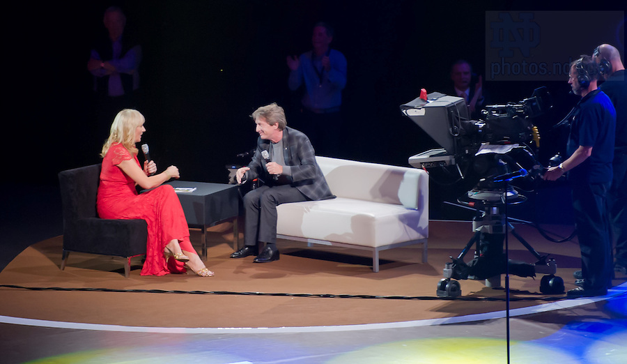 """Aug. 31, 2012; Comedian Martin Short speaks with presenter Mirriam O'Callaghan at the """"Notre Dame a Welcome Home"""" pep rally at O2 arena in Dublin...Photo by Matt Cashore/University of Notre Dame"""