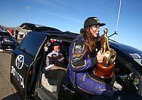 Mar 30, 2014; Las Vegas, NV, USA; NHRA funny car driver Alexis DeJoria celebrates after winning the Summitracing.com Nationals at The Strip at Las Vegas Motor Speedway. Mandatory Credit: Mark J. Rebilas-