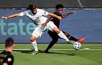 LOS ANGELES, CA - AUGUST 22: Emiliano Insua #3  of the Los Angeles Galaxy and Latif Blessing #7 of LAFC battle for a loose ball during a game between Los Angeles Galaxy and Los Angeles FC at Banc of California Stadium on August 22, 2020 in Los Angeles, California.