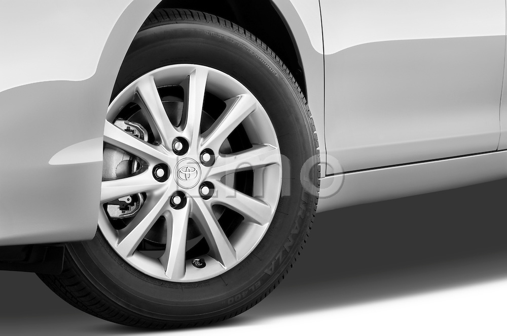 Tire and wheel close up detail view of a 2010 Toyota Camry Hybrid