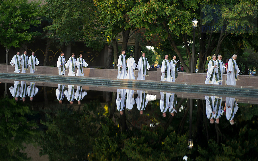 September 11, 2011; Concelebrants walk along the reflecting pool on their way to the Hesburgh Library Quad to attend the special outdoor mass of remembrance for the 911 attack victims at the University of Notre Dame. Photo by Barbara Johnston/University of Notre Dame