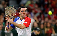 Viktor Troicki of Serbia returns a ball to Michael Llodra of France during their Davis Cup Final match in Belgrade, Serbia, Sunday, Dec.5, 2010..(Srdjan Stevanovic/Starsportphoto ©)