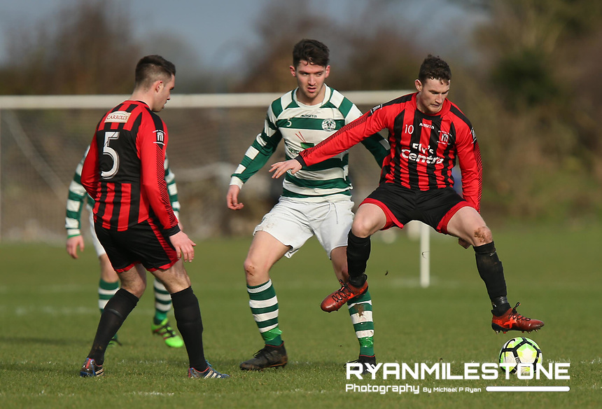 Peake Villa's Stephen Carroll in action against Nenagh Celtic's Paul Walsh during the Munster Junior Cup 4th Round at Tower Grounds, Thurles, Co Tipperary on Sunday 28th January 2018, Photo By: Michael P Ryan